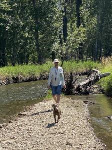 Man walking with his retriever dog near the Stillwater River